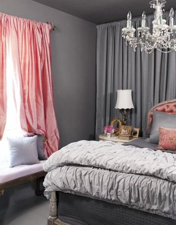 charcoal gray & salmon pink romatic bedroom design with gray walls, salmon pink silk, drapes, gray pintuck bedding, salmon pink tufted silk headboard and crystal chandelier. Benjamin Moore Amherst Gray