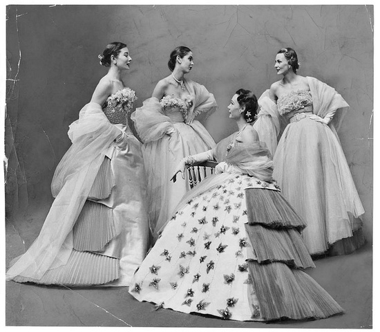 A quartet of elegant models wearing sublimely beautiful Jacques Fath evening dresses. #vintage #fashion #1950s