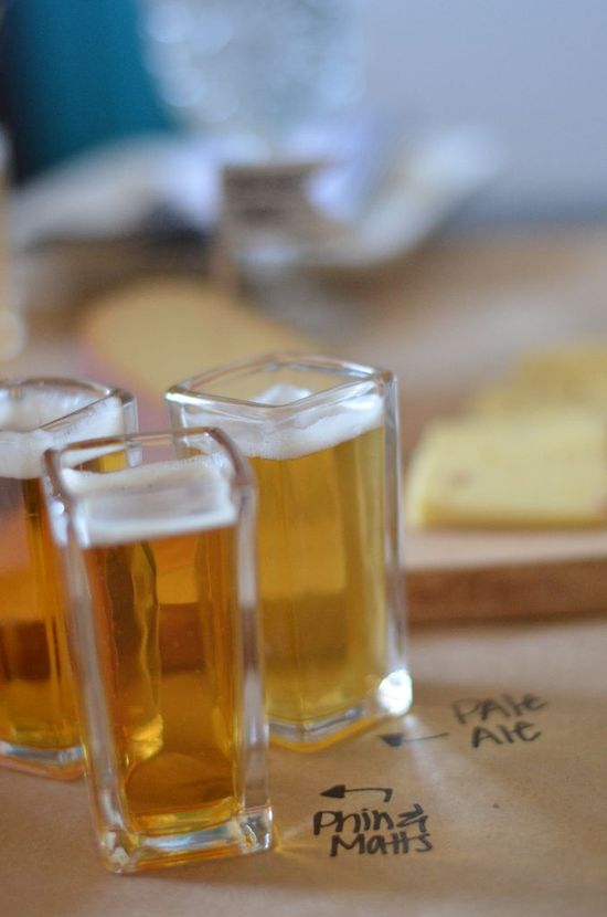 We used square shot glasses as tasting glasses, the perfect three ounce pour of different beers to try. The beers being tried were labeled with marker on our craft paper table runner