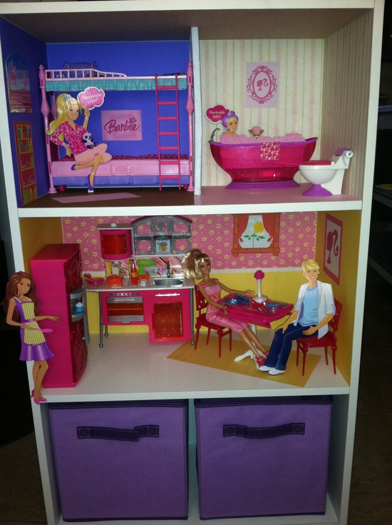 Homemade Barbie house out of $16 shelves From Target. Scrapbook paper for wallpaper and bins for storage.