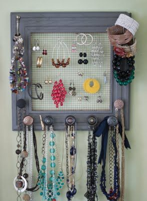 Wire mesh (rabbit fencing or other), frame, mismatched door knobs, and you have DIY jewelry holder. Awesome.