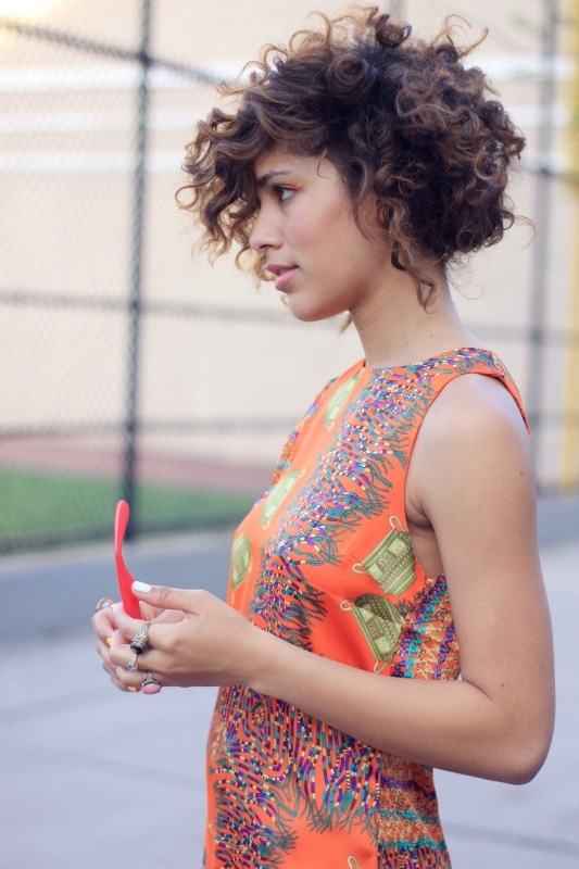 Curly short hair.
