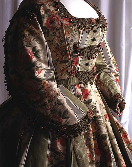 Dress. I would think this is an evening bodice with the beadwork. Lovely!