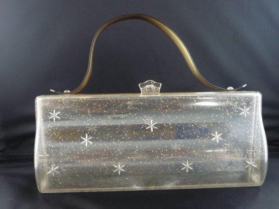 Vintage 1950s starburst-patterned lucite purse