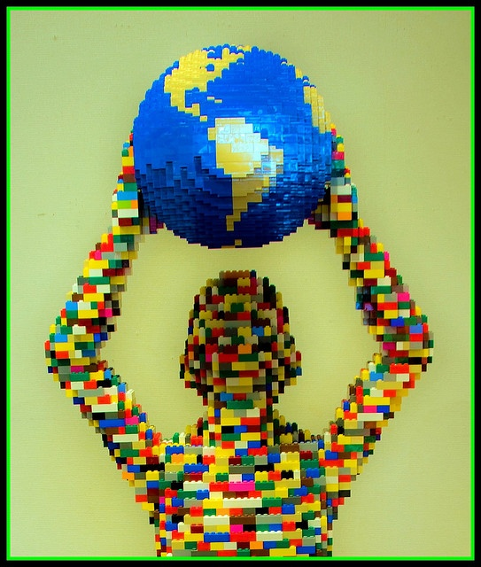 Rainbow Lego Man holding the World in his Hands