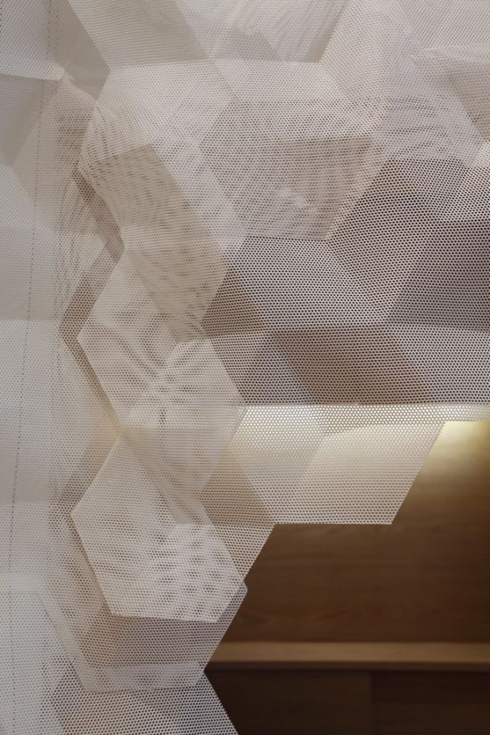 Shang XIA / Kengo Kuma -  fabric (triaxially folded) covers the entire interior. It is a material which comes between cloth and plastic, which can retain the softness of natural cloth and strength of shape-memory texture.