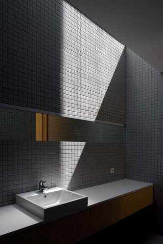 Casao_057_large. Strip skylight. Bathroom small charcoal tiles. Simple. Refined. Slim strip mirror.