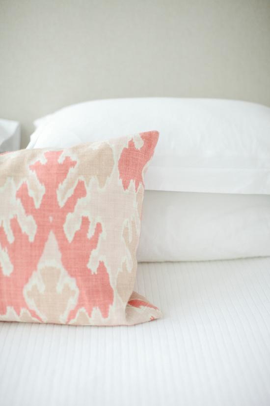 throw pillow on white linens