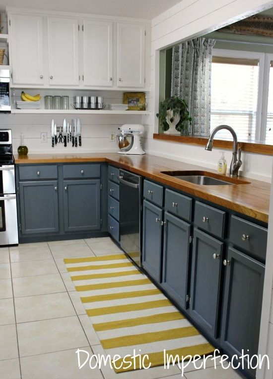 Awesome, economical kitchen redo. Moved old cabinets up and painted, added an open shelf, planked walls with plywood