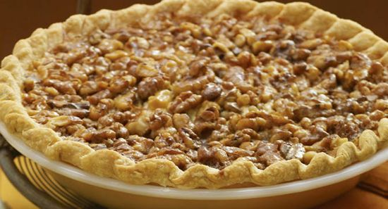 Vanilla Walnut Pie : This pie is a novel take on two tried and true holiday desserts: pecan pie and cheesecake. A layer of smooth cream cheese is a perfect complement to the walnuts' satisfyingly sweet, nutty crunch.