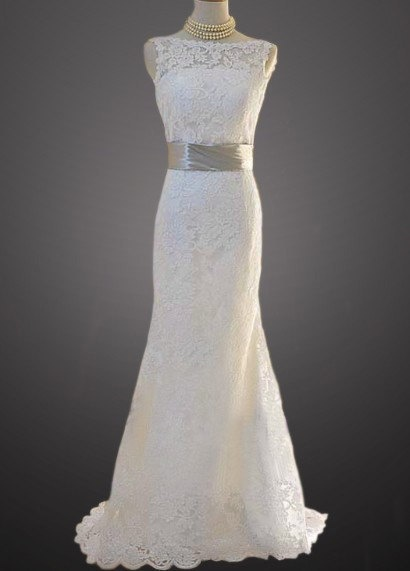Vintage Lace V-Shape Open Back Fit and Flare Style Bridal Gown With Buttons, Satin Sash and Scalloped Edges.