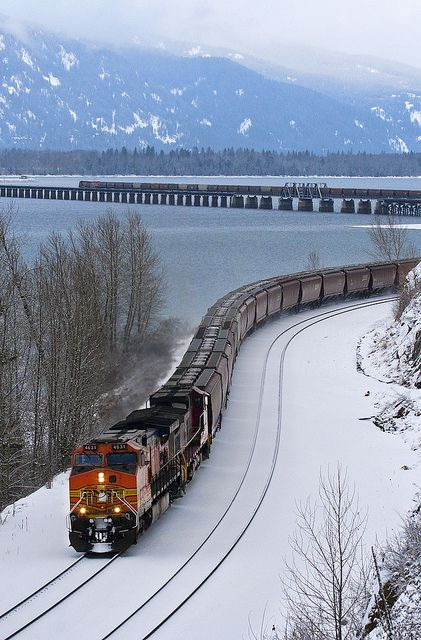 Lake Pend Oreille shimmers beneath a westbound grain train at Bottle Bay Rd. near Sandpoint, Idaho