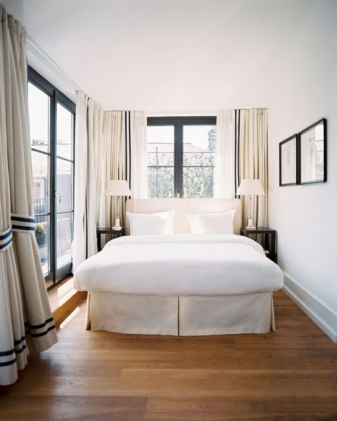 Bedroom Photo - Black trim on white curtains in a neutral bedroom