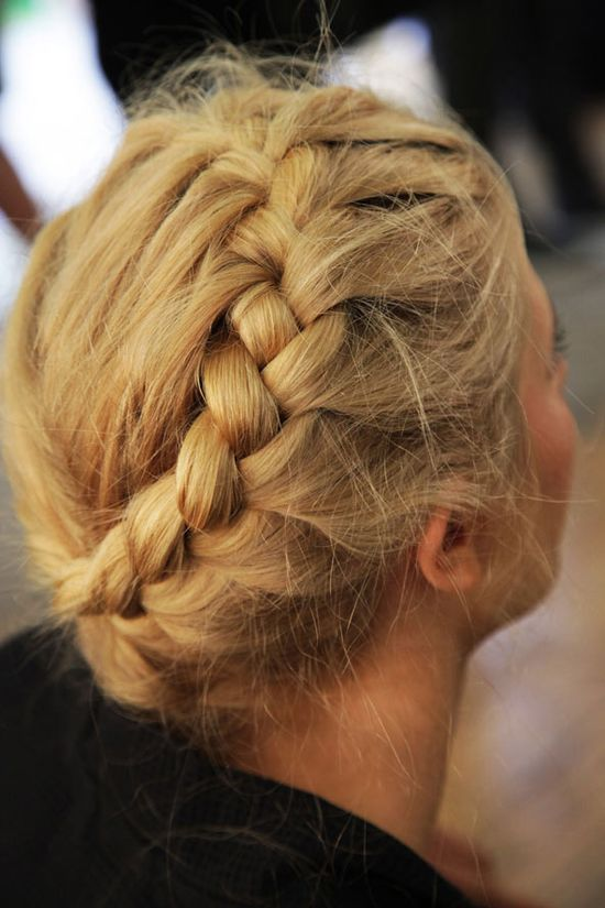 Pretty halo braids were the hot style at Erdem S/S 2011. To try this look at home, start at the nape of your neck and plait round to the top, pulling sections from the front in to create the french plait.