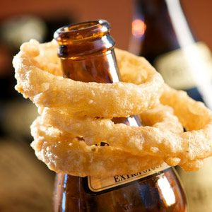 Golden crispy homemade onion rings--these are really worth the extra effort! This recipe features fresh-cut slices of sweet Vidalia onion dipped in a hearty buttermilk and Irish beer batter, served fresh-fried crunchy and delicious.