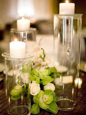 Flower-Accented Candle Centerpieces    We're used to seeing big floral arrangements surrounded by small votives, so switch it up with a small posy of flowers paired with raised candles.