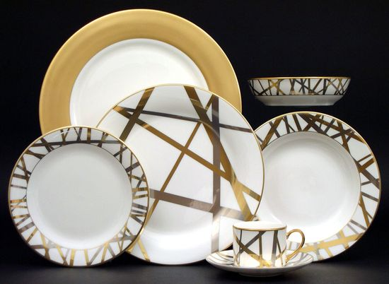 Kelly Wearstler - Mulholland features platinum and gold stripes that overlap and appear to wrap around each piece.