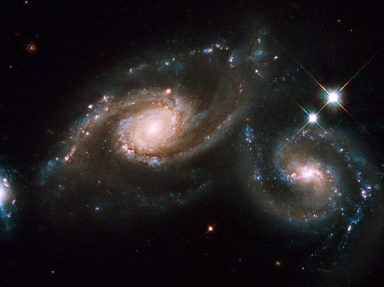 looks beautiful....from here! NASA - The Colliding Spiral Galaxies of Arp 274