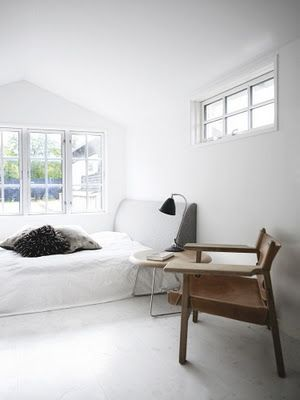 simple white bedroom + lovely wood chair