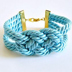 DIY Easy Knotted Bracelet by towonhousetanya: Only a couple of dollars to make!  DIY #Bracelet #Knot  Note how rope is clamped at each end ... very nice