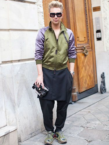Fall 2013 Couture Week Street Style: Kyle, wearing a Burberry jacket, Givenchy pants, and Marc Jacobs glasses