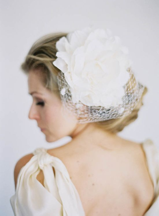 oversized flower hair accessory // photo by Jen Huang, accessory by Olivia Nelson, styling by Borrowed Blu // view more: ruffledblog.com/...