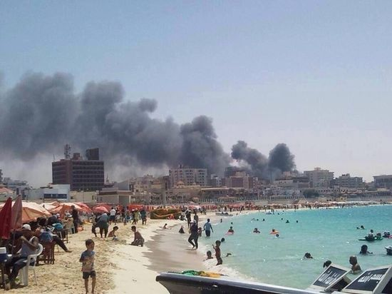 Surreal Photo Of Egyptians At The Beach While City Burns In The Background