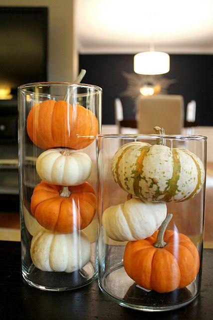 Mini pumpkins in glass containers. #Fall #Halloween #Autumn #Pumpkins
