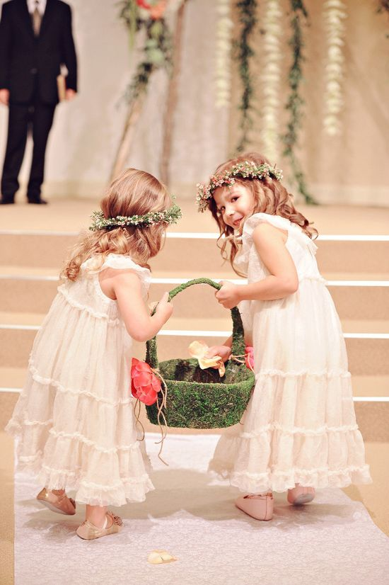 Flower girls carry one basket together....cute idea