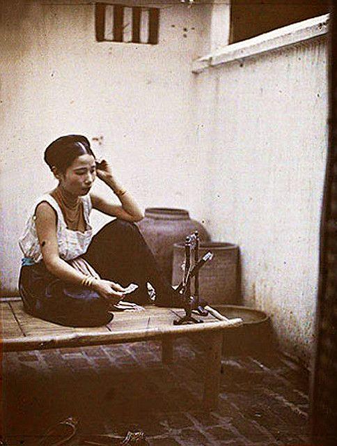 Hanoi woman putting make up on. circa: 1914-15