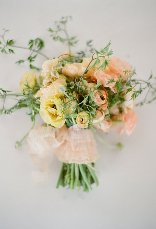 yellow and peach ranunculus bouquet photo by Elizabeth Messina