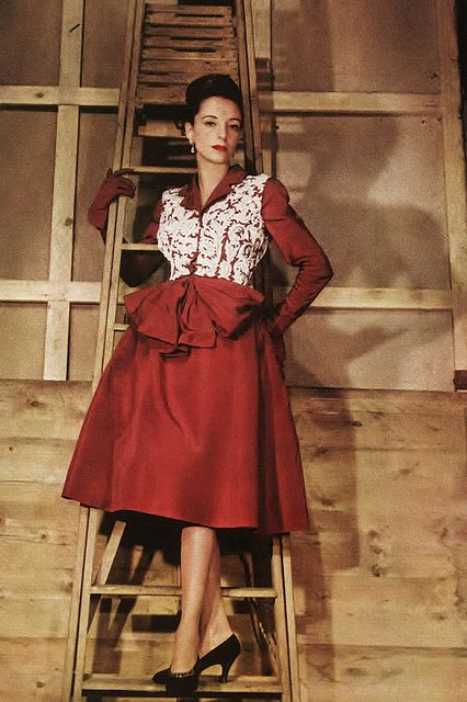 An elegantly lovely mid-1940s dinner dress of red taffeta with baroque-embroidered waistcoat (vest) by designer Cecil Beaton. #red #1940s #vintage #fashion #dress