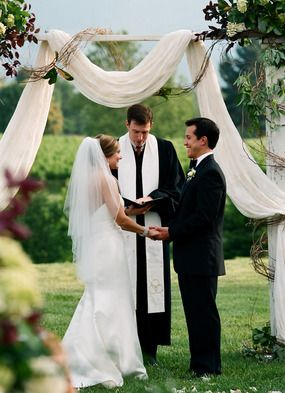 Loosely draped fabric with floral accents #ceremony #backdrop #wedding #decor