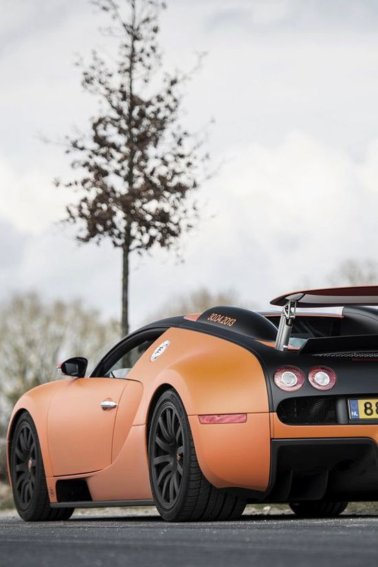 Seriously Cool Orange Bugatti Veyron! Click on the Bugatti to win a cash prize.