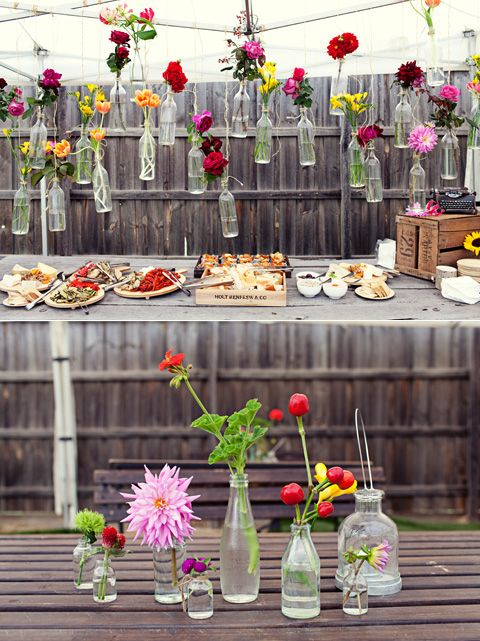 loved this inspiration for our wedding decorations. would be great for entertaining outdoors... or indoors!  i'm smitten with the assorted bottles/jars & bright flowers.