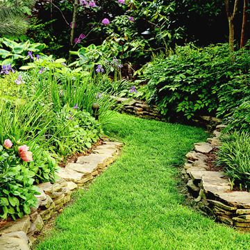 Who says pathways have to be made from stone, brick, or other hard surfaces? The easiest pathway is a simple swath of grass.
