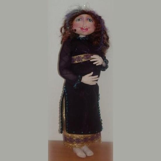 Pregnant cloth doll.