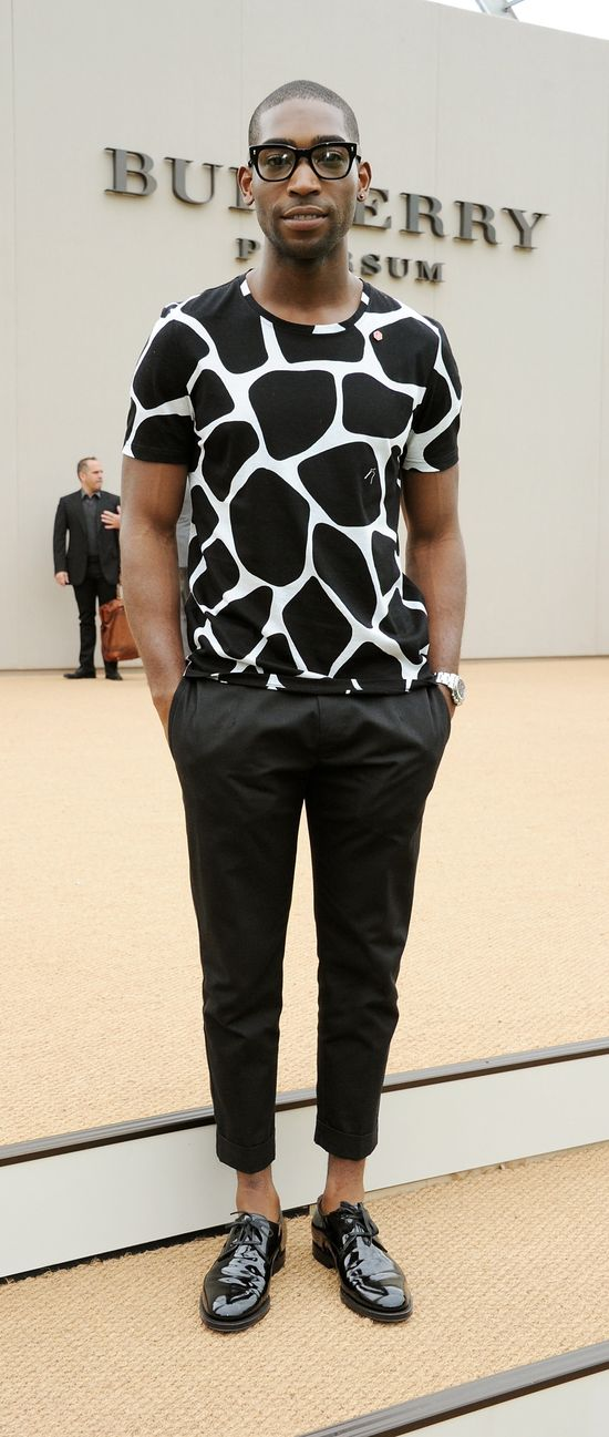 British musician Tinie Tempah wearing Burberry Prorsum outside the Burberry S/S14 show space in Kensington Gardens, London