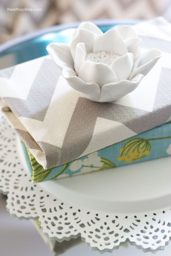 Old books covered with fabric... simple and inexpensive!  #DIY #homedecor