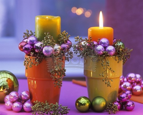 Arrangement of candles, eucalyptus and Christmas baubles