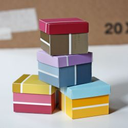 Learn how to make boxes from leftover paint swatches