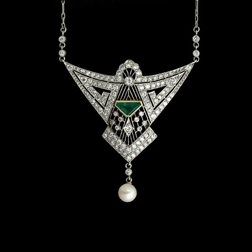 Platinum Art Deco diamond, emerald, and pearl necklace, c. 1920's. The geometrically designed diamond set plaque is expertly pierced and finished with fine milgrain details and is centered with a vibrant emerald set in a yellow gold bezel. A lustrous cultured pearl sways below.