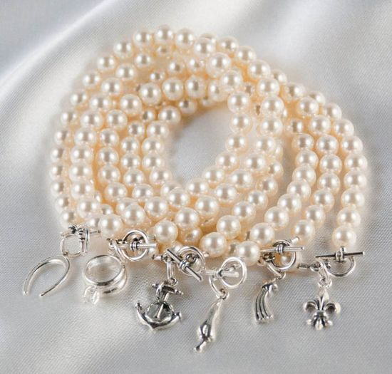 """Wedding Cake Pull Bracelets by BlueLaceBoutique on Etsy, $115.00. """"Ribbon pulling"""" dates back to Victorian times when tiny silver charms attached to ribbons were placed inside the cake by the bride for her single friends to pull."""