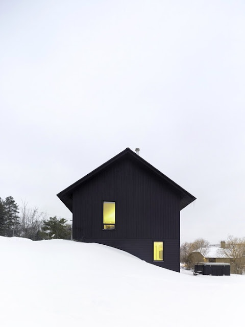 Black house in snow photo