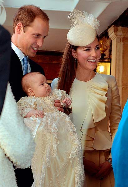 Proud parents William and Kate with their son Prince George on his christening day