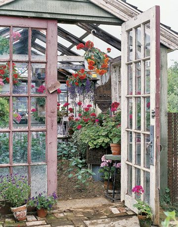 ::a greenhouse built with salvaged windows::
