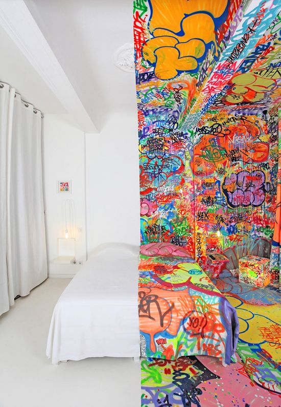 Jekyll-and-Hyde contrast has been crystallized in a hotel room in Marseille, France, where artist Tilt has left his mark in the form of a half-graffitied interior.