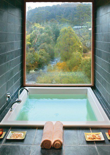 a hot bath that contains a handful of epsom salts, 10 drops of lavender essential oil, and a half cup of baking soda draws out toxins, lowers stress-related hormones, and balances your ph levels.  (And I want this room)