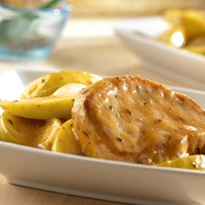 Savory pork chops simmer in the slow cooker with tart Granny Smith apples and onions in a sweet and savory sauce that complements the pork and apple combination.