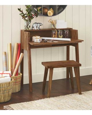 This desk is has storage and is a space-saver! Get it here:http://www.bhg.com/shop/vivaterra-foldaway-desk-and-set-me-down-anywhere-stool-p5098e81be4b042c857cdb36a.html